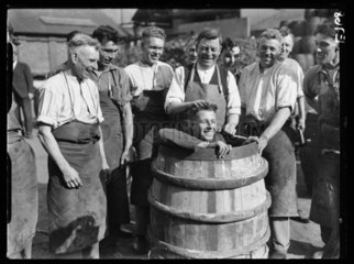 Coopers with a man in a barrel  1934