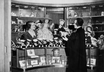 Shop on the 'Queen Mary' selling dolls dressed as sailors  28 May 1936.