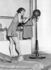 Fitness and workout costume at the Ideal Home Exhibition  7 April 1931.