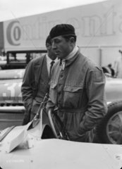 Pierre Veyron stands beside a Bugatti Type 54 racing car  Berlin  1933.