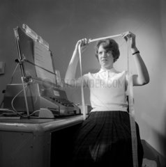 Model 803 computer: woman engineer working on tape rectification  1962.