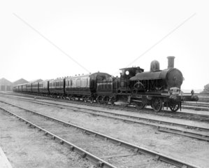 2-4-0 locomotive and train at Wolverton Works  1893.