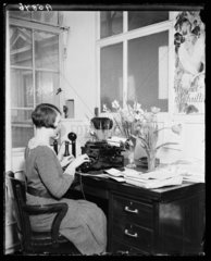 Typist working in a 'Brighter England' office  22 March 1932.