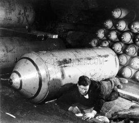 Man writing letter beside bomb  12 November