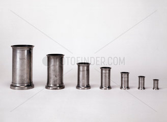 Seven liquid measures made from pewter  1851.