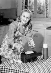 Woman packing a lunch box  1953.