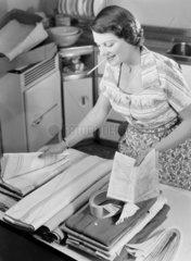 Woman checking laundry  1950.