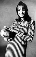 Model holding a pumpkin for Halloween  30 October 1964.