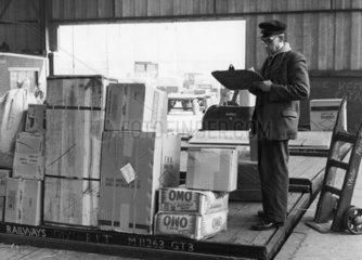 Clerk checking goods on a British Rail wagon  Stoke  c 1960s.