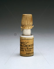Bottle of Dentin toothpowder  1901-1940.