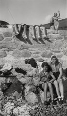 Young women on a beach  c 1940s-1950s.