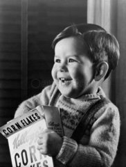 Little boy with a cereal packet  1948.