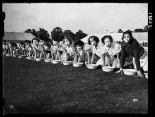 Girls ducking for apples  1935.