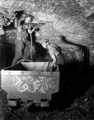 Miners using a pneumatic drill  Rhondda Valley  South Wales  25 June 1931.
