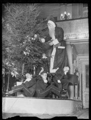 Father Christmas and page boys  1933.