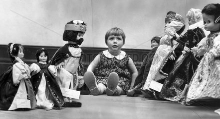 Child with dolls in period costume  Blackpool  May 1966.