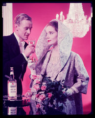 Couple drinking gin martinis  1960s.