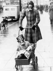 Mother and child wearing their gas masks  Southend  29 March 1941.