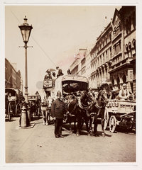Policeman on a busy street  c 1900.