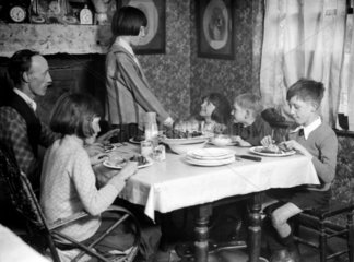 Motherless family  27 January 1933.