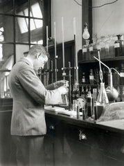 Conducting a volumetric analysis experiment  17 July 1931.