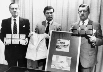 Police with items used in a gold robbery  c 1983.