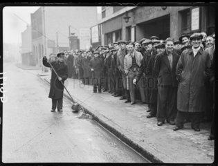 Queue of unemployed men  Stepney  London  1938.