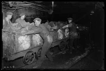 Moving coal in the Number 1 Pit in Powell  Wales  1931.