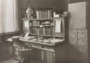 The office of a scientific instrument maker  1850-1950.