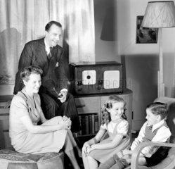 Family listening to the radio  1948.