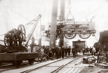Loading a steam locomotive onto a ship  Newhaven  East Sussex  late 1800s.