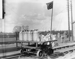 Dairymen transporting dairy products to the