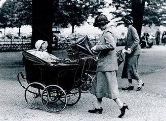 Nursemaids pushing prams in the park  c 1930s.