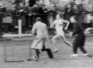 Roger Bannister running the four-minute mile  6 May 1954.