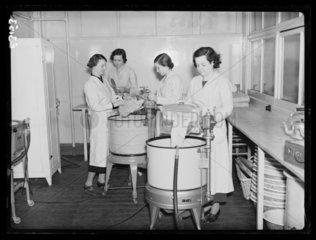 Young women using electric washing machines  1935.