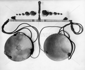 Cord pivot  balance and set of weights  ivory  Persian  16th century.