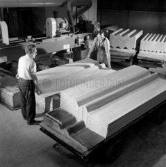 Men stack racks of finished asbstos roof sheets  Turner Asbestos  Widens 1962.