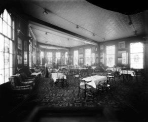 Dining room  possibly inside a London & North Western Railway hotel  c 1910.
