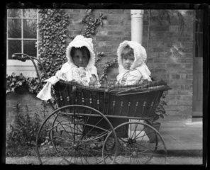 'Isobel And Pauline Adams In Pram'  c 1890.