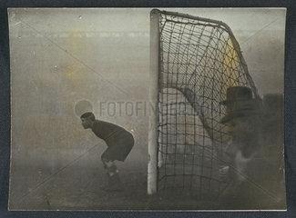 Russian goalkeeper Khomich peers into the gloom  21 November 1945.