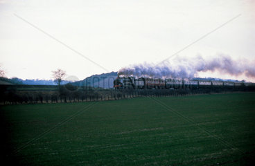 Steam locomotive pulling a passenger train.