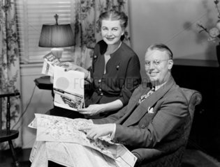 Couple planning a holiday  1949.