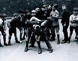 Boys fighting in the streets  10 July 1931.