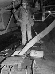 Workman filling Pres Flo wagon  c 1980s.