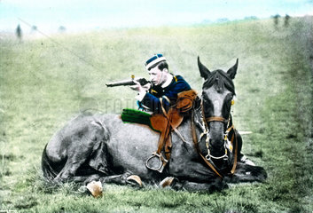 Cavalry soldier about to shoot  c 1900.