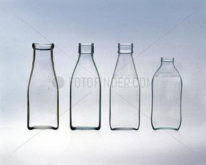 Four milk bottles.