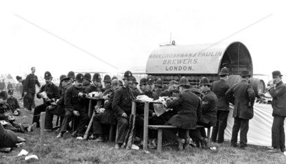 Policemen eating sandwiches at a country festival  c 1910.