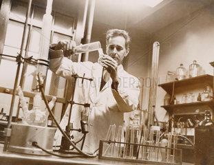 Dr Dennis Bauer in his laboratory  13 December 1963.