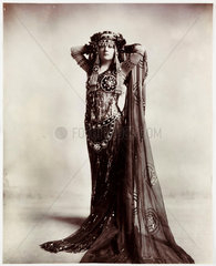 Woman dressed in an Egyptian-style costume  c 1900.
