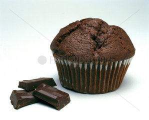 Chocolate cup cake with pieces of chocolate  2000.